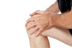 Erwachsener attraktiver Mann im Sportkleidungsknieschmerz-Verletzungsschmerz lokalisiert Lizenzfreie Stockfotos
