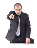 Erwachsener Geschäftsmann, der auf jemand zeigt Stockbild