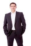 Erwachsener lächelnder Geschäftsmann mit dem schwarzen Anzug getrennt lizenzfreie stockfotografie