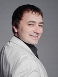 Erwachsener Mann in einer weißen teuren Klage stockfotos