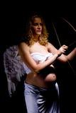 Erwartungsvolle Frau als Engel Stockbild