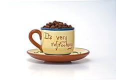 Es erneuert Tasse Kaffeebohnen Stockbild