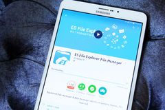 Es file explorer file manager app. Downloading es file explorer file manager application from google play store on samsung tablet Royalty Free Stock Image