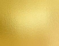 Es ist Tapetengoldfarbe Dekorative Beschaffenheit der goldenen Folie Lizenzfreie Stockfotografie