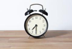 Es reloj del ` del 07:30 o Foto de archivo
