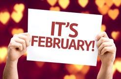 Es tarjeta de febrero con el fondo del bokeh del corazón foto de archivo
