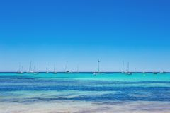 Es Trenc - amazing beach with beautiful clear water and lots of yachts, Mallorca Island. Spain Royalty Free Stock Photo