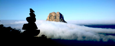 Es Vedra covered with cloud blanket Stock Image