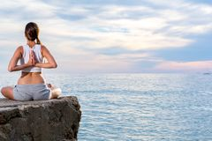 Attractive woman practice yoga at beach with sunset or sunrise in Es Vedra, Ibiza, Spain. royalty free stock photos