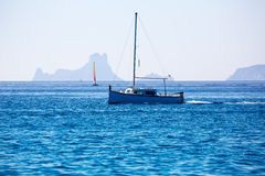 Es Vedra Ibiza silhouette with boats Formentera view Royalty Free Stock Photos