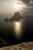 Es Vedra island in front of the setting sun. Panorama view of the island of Es Vedra, Ibiza royalty free stock images