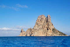 Es Vedra islet island in blue Mediterranean Stock Photography