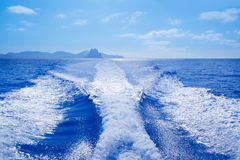 Es Vedra and Vedranell islands boat wake Stock Image
