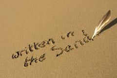 Es wird in den Sand geschrieben Lizenzfreie Stockfotografie