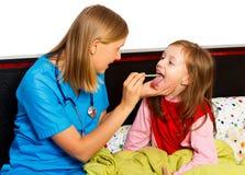 Esame della gola Immagini Stock