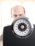 Esamini questo peso Fotografie Stock