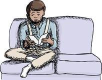 Menino que lê um livro Foto de Stock Royalty Free
