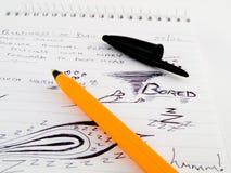 Esboços dos Doodles no bloco de notas do escritório do trabalho Fotografia de Stock Royalty Free