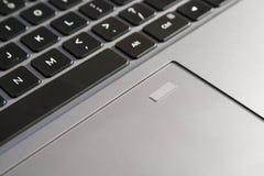 Escáner de la huella dactilar en el cojín de la pista, almohadilla táctil imagen de archivo libre de regalías