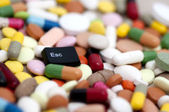 Esc key among drugs (escape from drugs) Royalty Free Stock Photography
