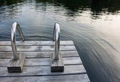 Escada de aço na doca de madeira Imagem de Stock Royalty Free