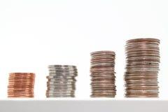 A escada pisou pilhas de moedas dos E.U. Fotografia de Stock