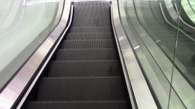 Escada rolante de um shopping filme