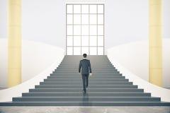Escadas com homem de negócios Imagem de Stock