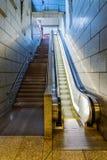 Escadas contra a escada rolante Fotografia de Stock Royalty Free