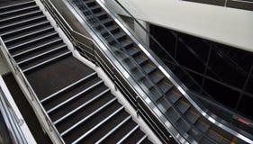 Escadas e escada rolante Foto de Stock