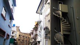 Escadas redondas fora das construções imagem de stock