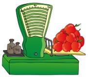Escala con las manzanas Imagen de archivo libre de regalías
