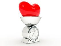 Escala da cozinha com coração gigante Fotografia de Stock Royalty Free