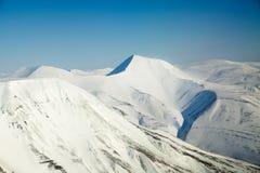 Escala de montanha da neve fotos de stock