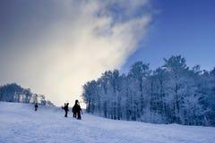 Escalada dos Snowboarders Foto de Stock Royalty Free