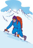 Escalador de montaña en la cumbre fotografía de archivo