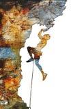 Escalador de roca que se aferra en un acantilado Fotos de archivo