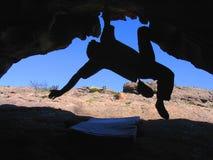 Escalador en cueva Foto de archivo libre de regalías