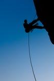 Escalador en la roca Fotos de archivo