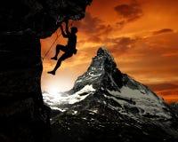 Escalador en las montan@as suizas Imagen de archivo libre de regalías