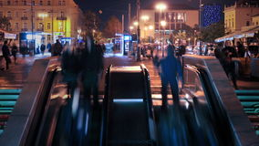 Escalaors and Tram station timelapse. Escalators and Tram station by night in Zagreb. people entering and exiting the subway stock footage