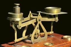 Escalas de cobre amarillo, tipo del balance Foto de archivo