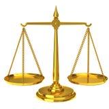 Escalas de oro de la justicia Imagen de archivo libre de regalías