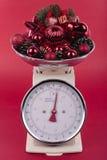 Escalas de peso com decorações Fotos de Stock