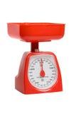 Escalas rojas de la cocina Imagen de archivo libre de regalías