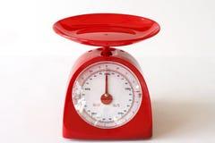 Escalas vermelhas da cozinha. Fotografia de Stock Royalty Free