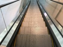 Escalater. Going down to lover floor by escalater Stock Photo