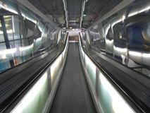 Escalator 02. View from the top of an escalator inside a tunnel Stock Images