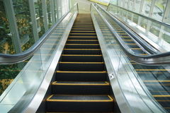 Escalator. In an modern airport Royalty Free Stock Image