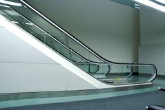 Escalator. A escalator for transportation going up or down Royalty Free Stock Image